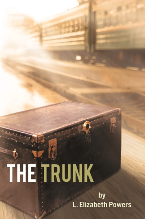 A large trunk sits abandoned at a railway station