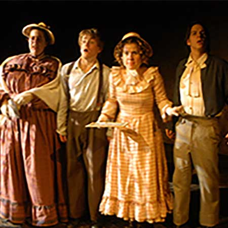 image of college students in costume performing a play