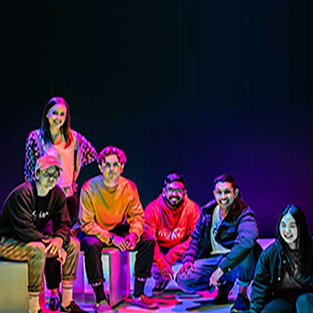 image of high school students performing a play