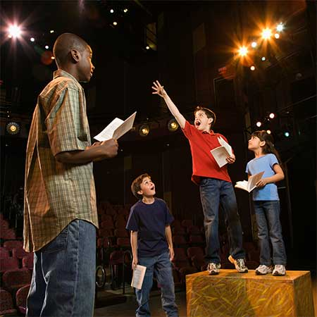 image of middle school theatre students performing a play